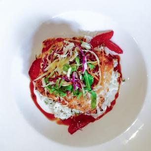GRILLED ASIAN SPICED SALMON BOWL basmati rice, sriracha slaw, blood orange segments, yuzu sauce